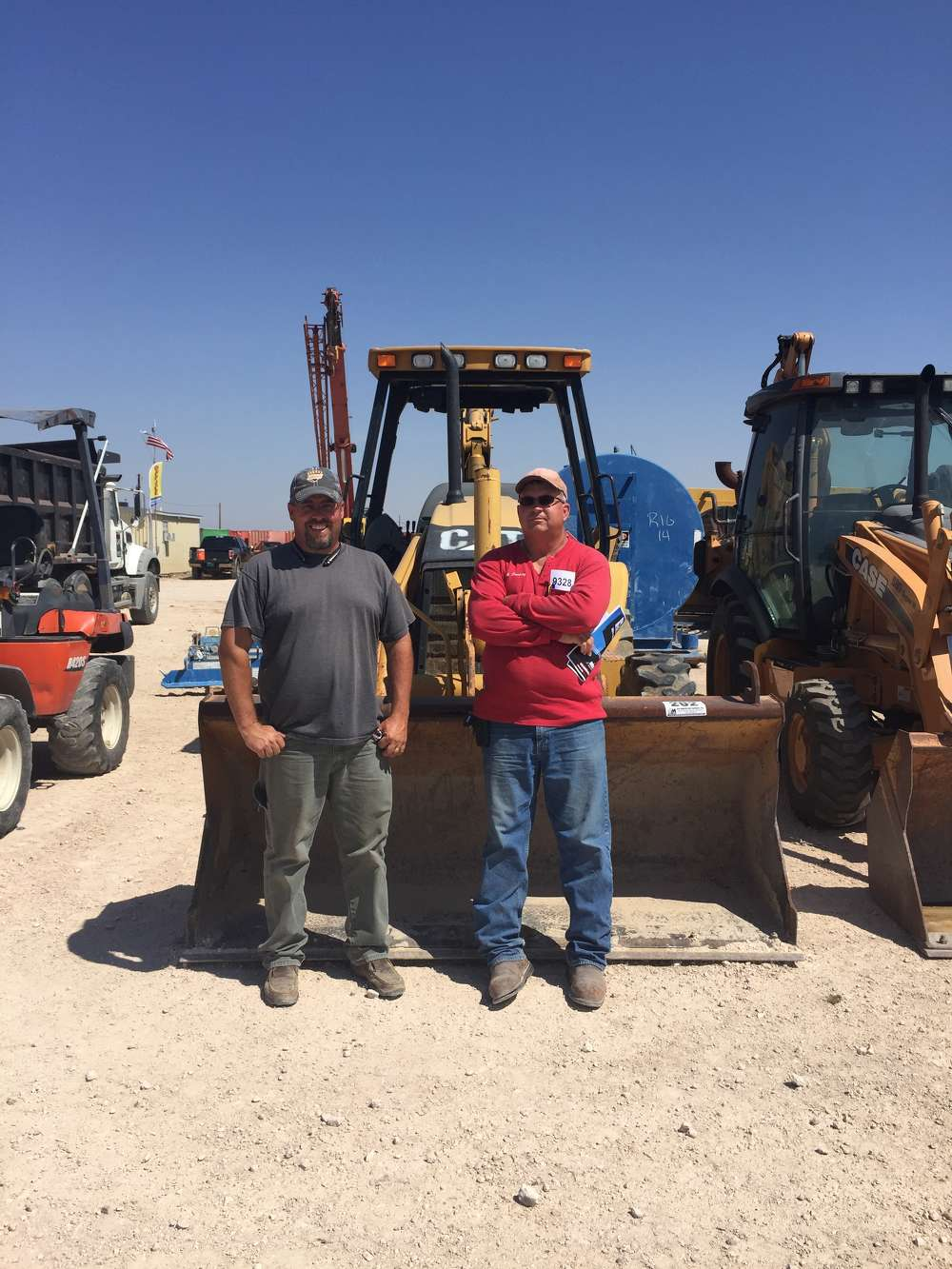 These gentlemen were inspecting a 2005 Caterpillar 420D loader backhoe in line for the Stanton, Texas, auction.