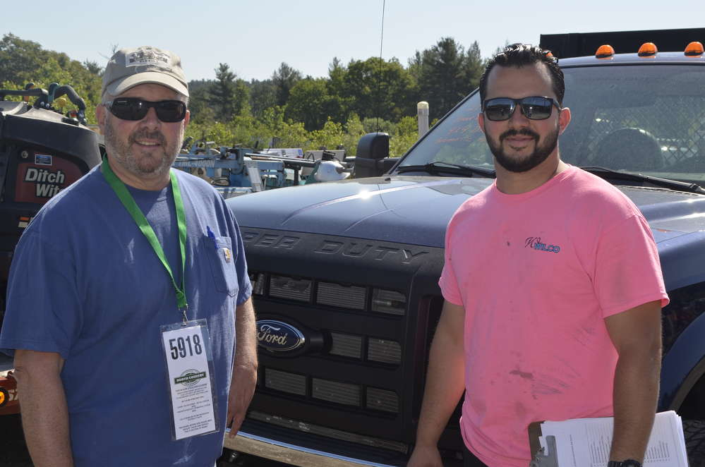Bill Wilbur (L) and Chris Wilbur, co-owners of Wilco Development of Warwick, R.I., are interested in this Ford truck.
