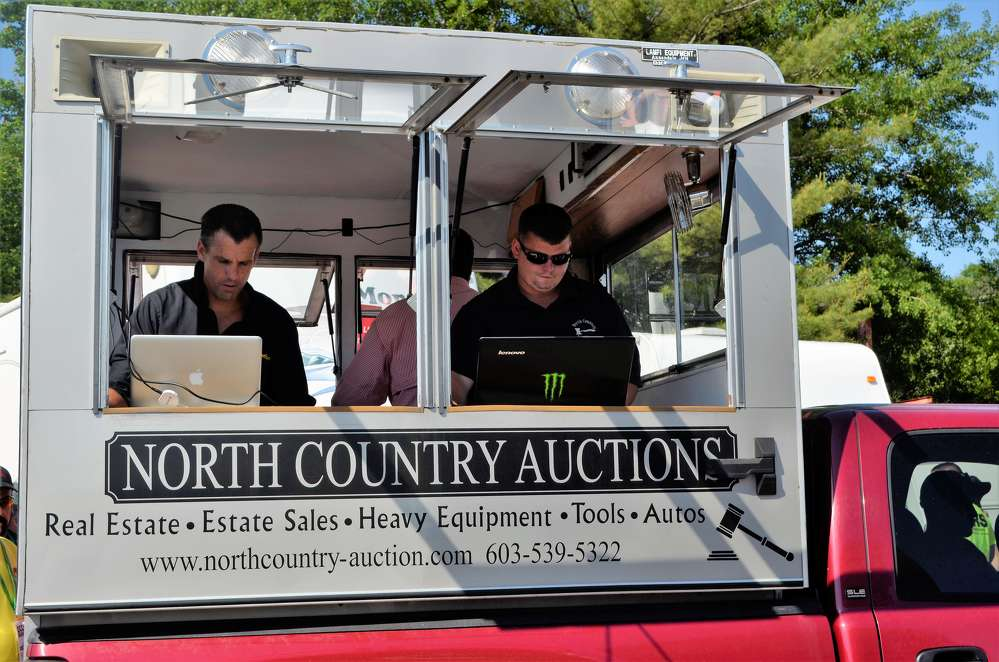 North Country's team travels around the sale in mobile trucks to track the online bids coming in while the other auctioneers manage the ground bidders.