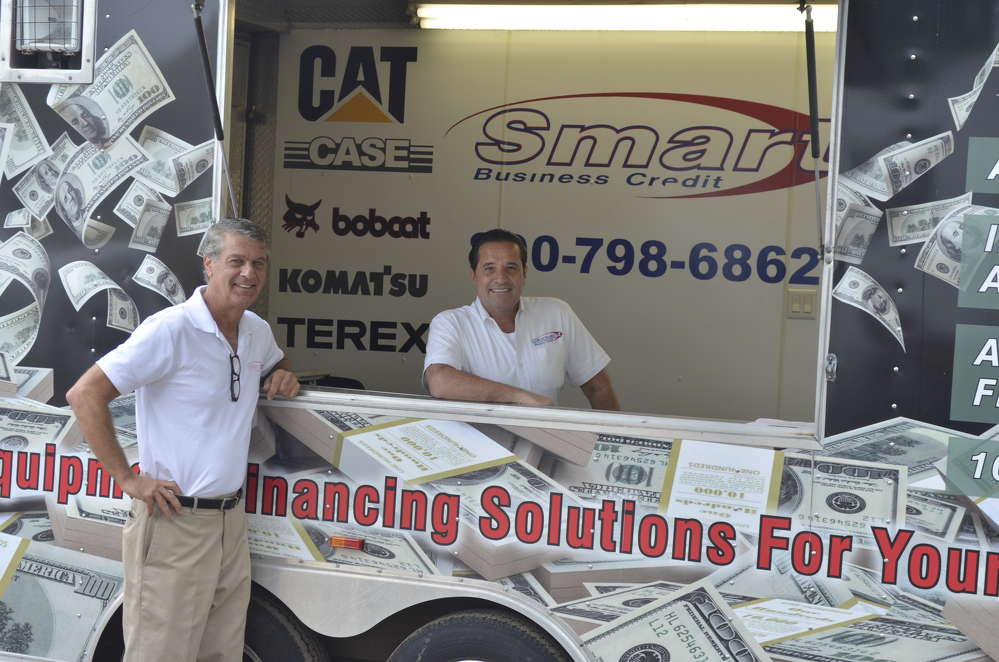 James Guarino (L), Northeast regional manager of Smart Business Credit, and Dean Schettino, loan officer of Smart Business Credit, located in Downingtown, Pa., were on hand to help customers with financing needs.