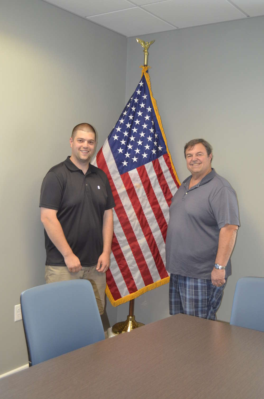 Jack Rifenburg (R) takes great pride in showing his son, Kenny Rifenburg, the new office facilities.