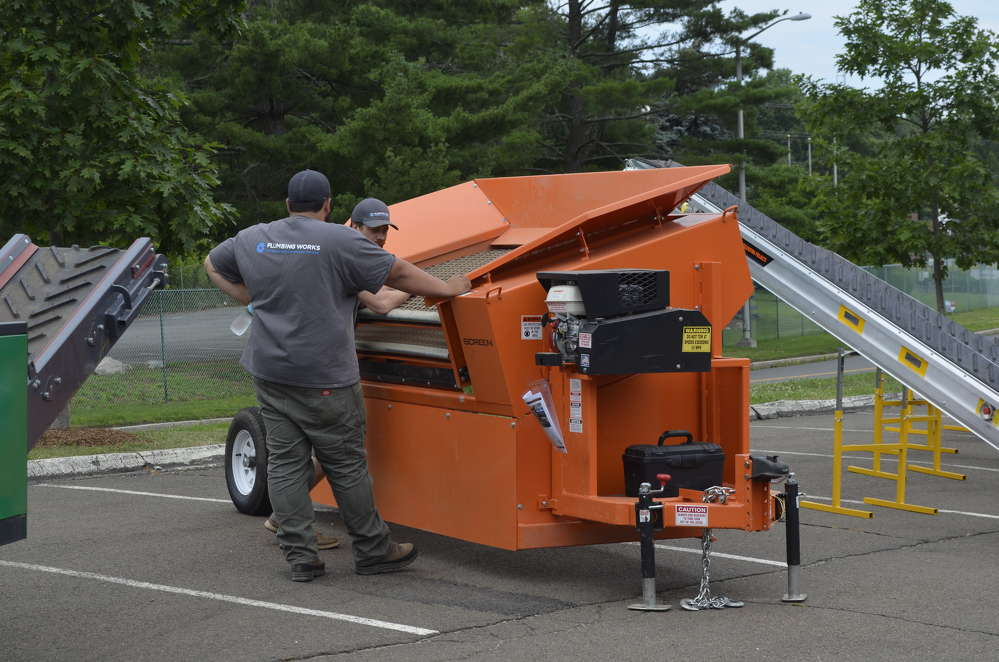 Area contractors check out the portable box screener available for rent from InterQuip.