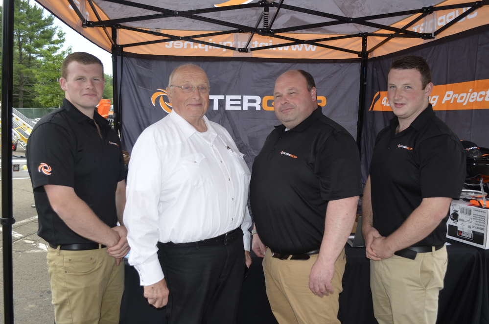 Three generations of the Davies family bring a commitment to designing innovative material handling equipment worldwide. Like his father before him, Karl Davies has established successful equipment businesses in Europe and North America. (L-R) are Jason Davies; Roger Davies; Karl Davies, director; and Joshua Davies.