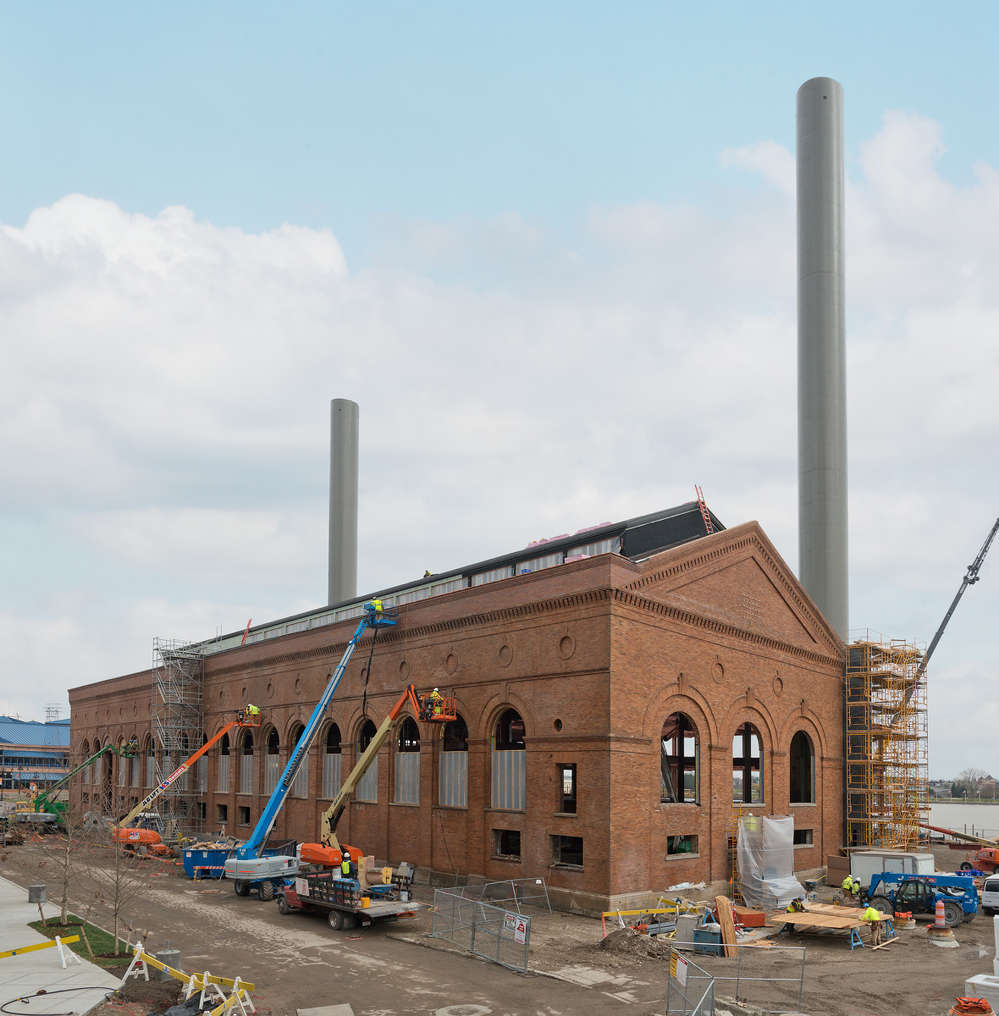 The work encompasses a seven-story parking garage, the renovation of a historic steam plant built in 1896 and the renovation of the existing top three floors of the former Key Bank building — all are connected.