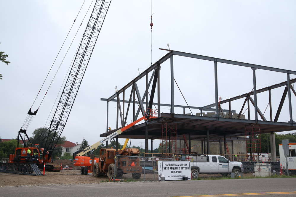 McGough rolls in a pair of Terex and Manitowoc cranes for the steel picks. Completing the concrete drum housing the planetarium was critical to the steel schedule because it is a load carrying structure for the museum.