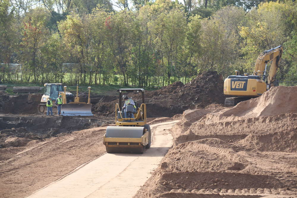Heavy equipment begins work on the outdoor learning plazas, storm water containment system and parking lot.