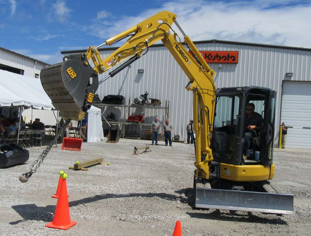 Josh Ritter, Southeast Equipment Company, operates a Kobelco SK35 SR in a rodeo-style demonstration at the event.