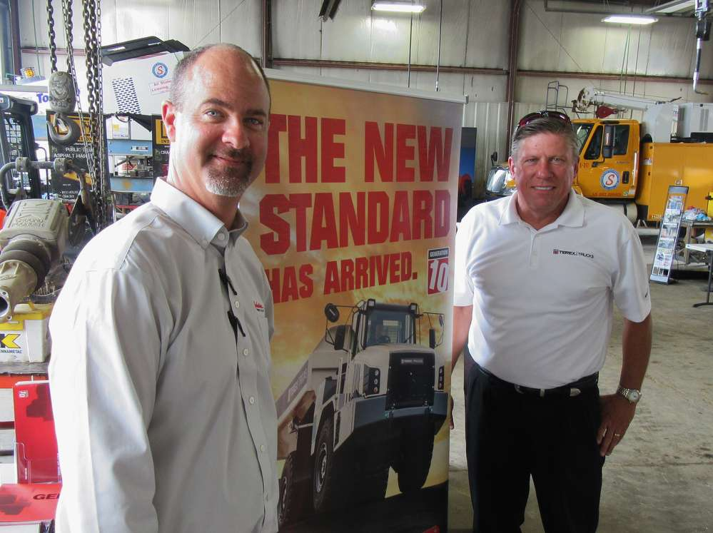 Doug Kyle (L), Southeastern Equipment Company Indianapolis sales representative, catches up with Greg Gerbus, Terex Trucks regional sales manager.
