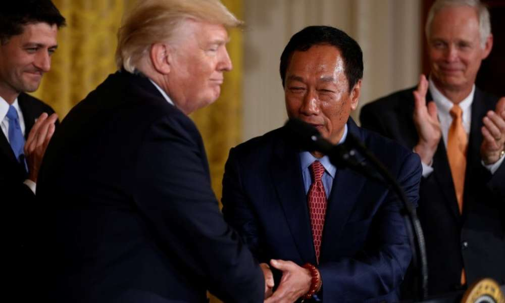 President Trump shakes hands with Foxconn CEO Terry Gou.
