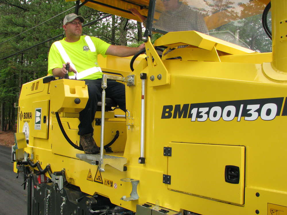 Michael Steele, Paulding County DOT machine operator, likes the Bomag BM1300/30 cold planer's visibility on any project and can easily see the start and stop points for milling.
