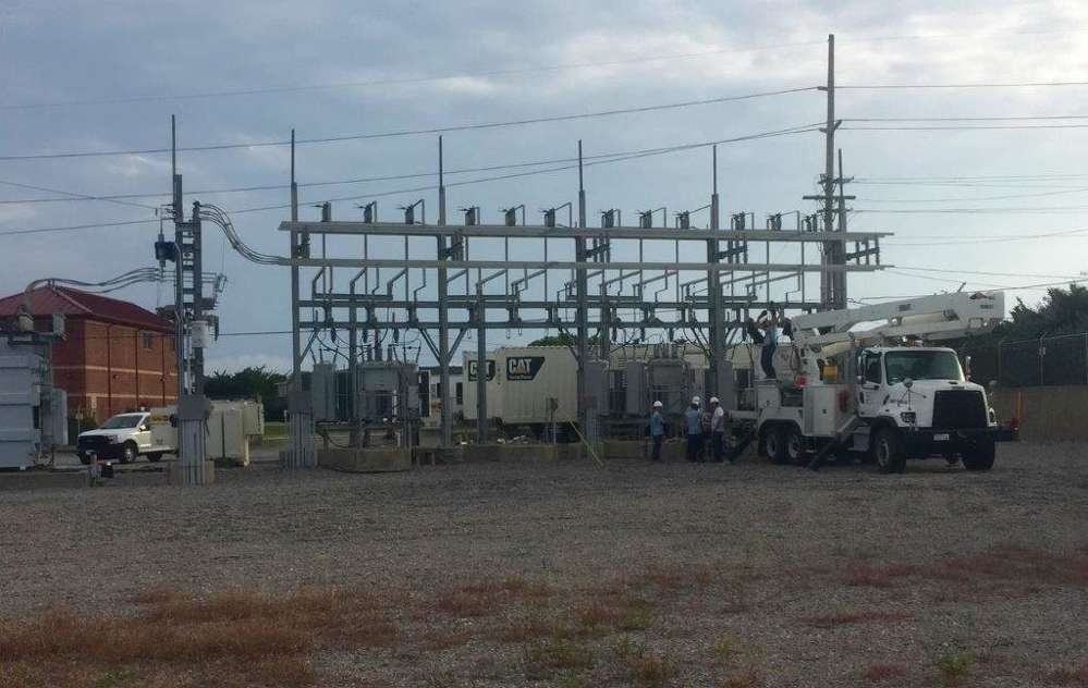 Crews set up generators to provide power for homes and businesses.  (Photo courtesy of Gregory Poole)