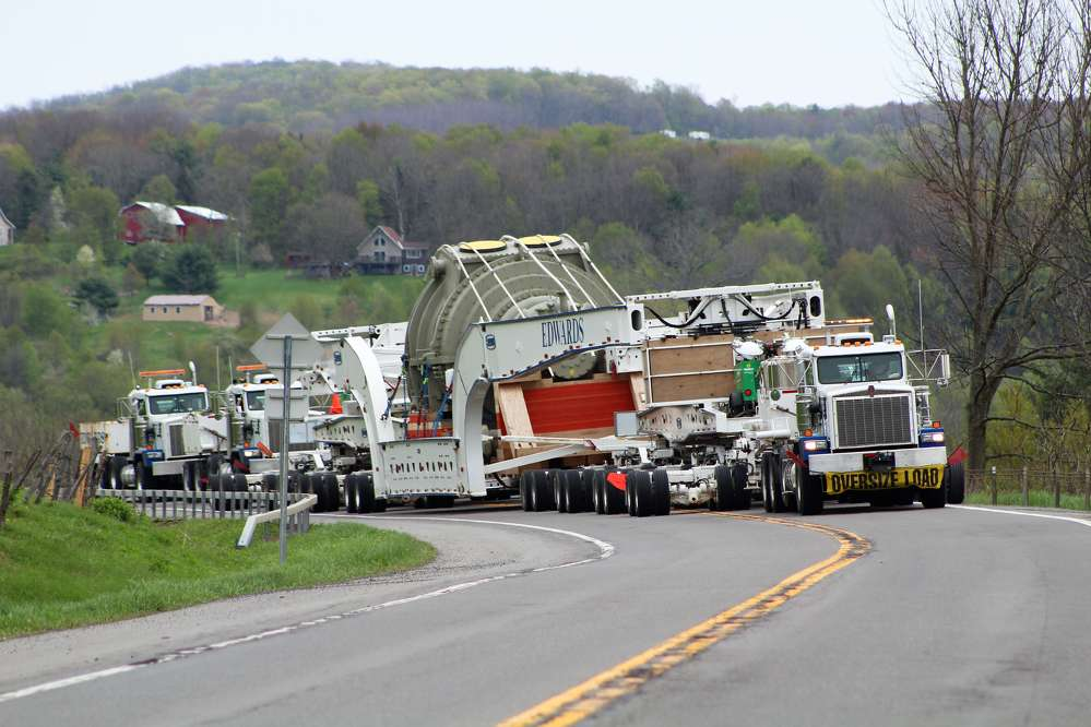 Instead of using huge 12-foot-wide prime movers—which are not typically equipped to get up to highway speeds and can only be operated on roads and highways under the restrictions of state and local conditional use—Edwards Moving and Rigging relies on several Kenworth C500 trucks to haul their payloads.