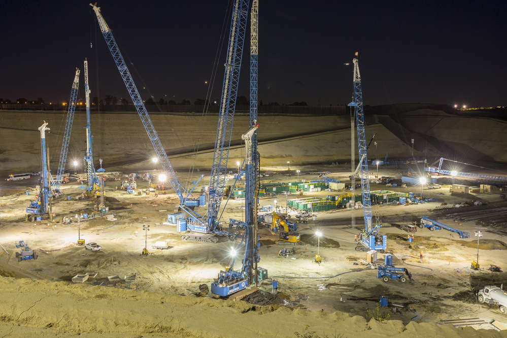 Some of the cranes were so tall that they required Federal Aviation Administration approval for use at the location, just blocks away from the busy Los Angeles International Airport.
