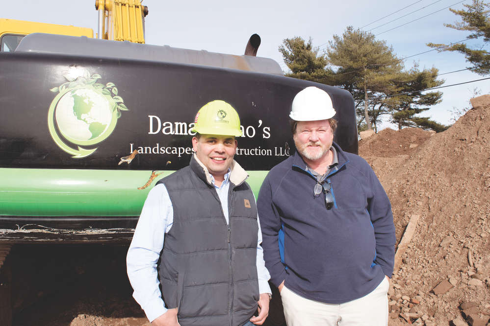 "Damasceno's Landscapes & Construction President Eddie Damasceno (L) calls on Ehrbar Sales Representative Andy Jett to help manage the company's growing fleet. ""We have experienced a lot of growth recently, and the service we get from Ehrbar helped make that possible,"" commented Eddie."