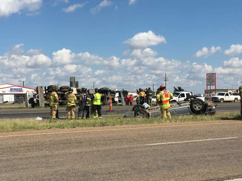 The crane took evasive action to avoid the Dodge Magnum, but still collided with the car. The crane went on to the center median and flipped onto its side. (Photo Credit: KCBD)