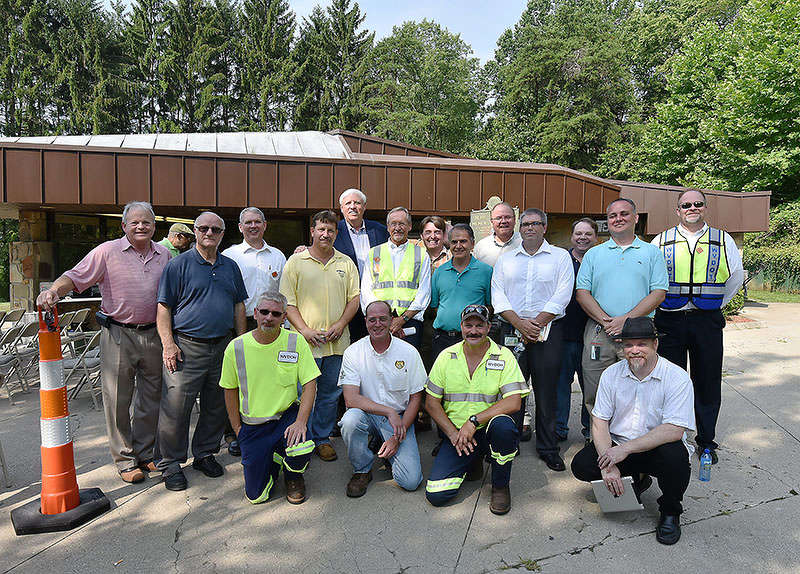 Division of Highways employees with Gov. Jim Justice (standing, fifth from L) at the Hurricane Rest Area on July 20.