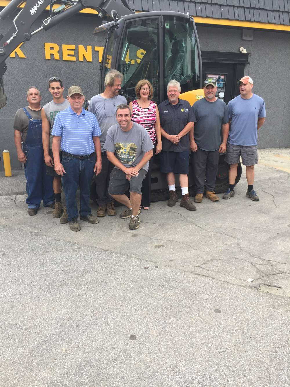 The OK Rental team. (L-R): Steve, service manager; Kevin, yard manager (Owner Ron Scoleri Sr.'s grandson); Ron Scoleri Sr., president; Tony, service technician, Dave, parts counter manager; Anna, office manager; Barry, service technician, Brad, service technician; and Ron Scoleri Jr., general manager.