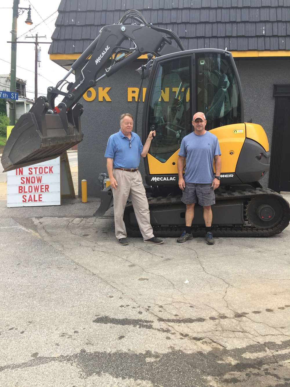 John McCusker (L), Mecalac machine specialist, and Ron Scoleri Jr., general manager, both of OK Rental.