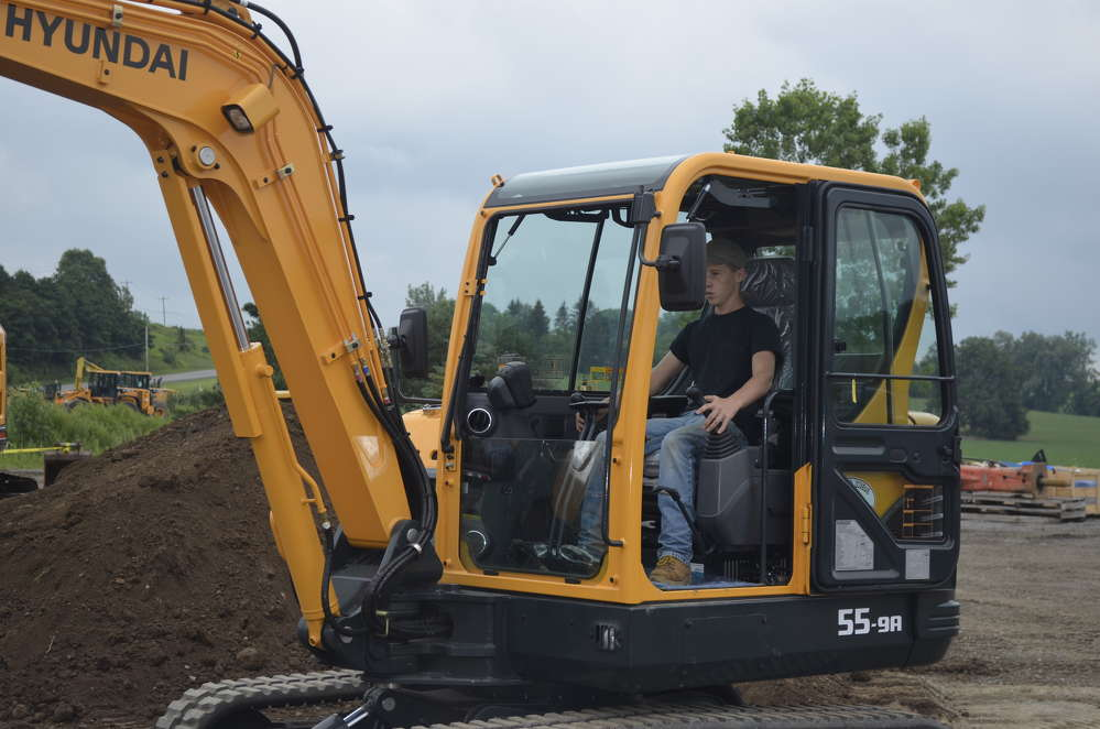 Daniel Turner from Pavilion, N.Y., takes his turn at the controls of a Hyundai 55-9A compact excavator.