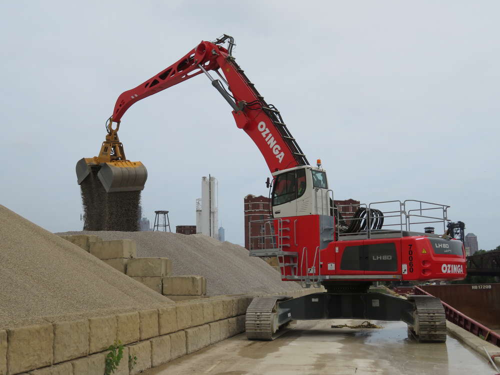 The operator of the Liebherr LH-80 material handler unloads material at the Ozinga Chinatown plant.