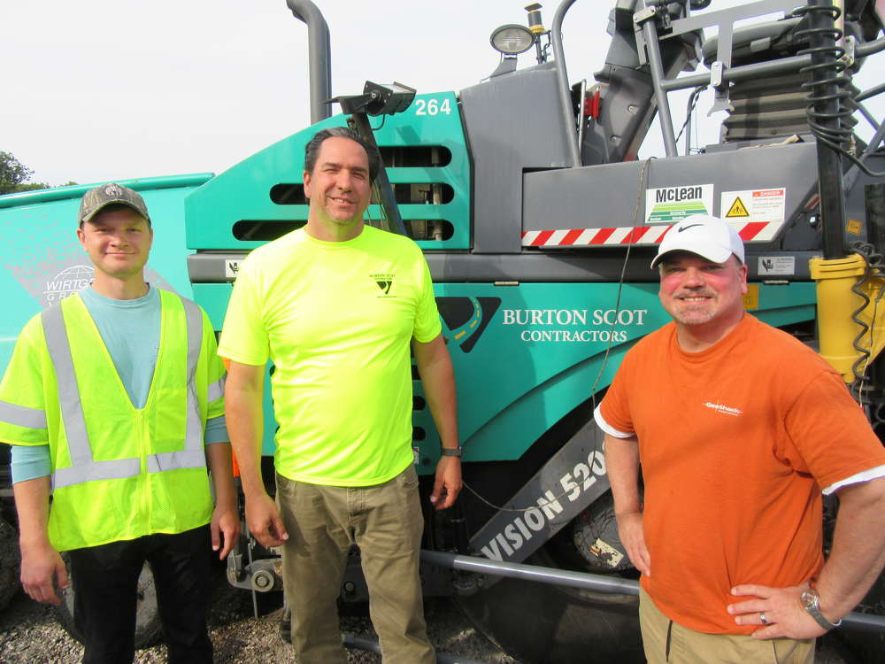 Grant Wasielewsk, Burton Scot Contractors' engineer intern of Ohio State University, joins Scot Paulitsch, Burton Scot Contractors president, and Greg Koly, GeoShack senior machine control specialist, to review the progress on the Cuyahoga County Airport runway project.