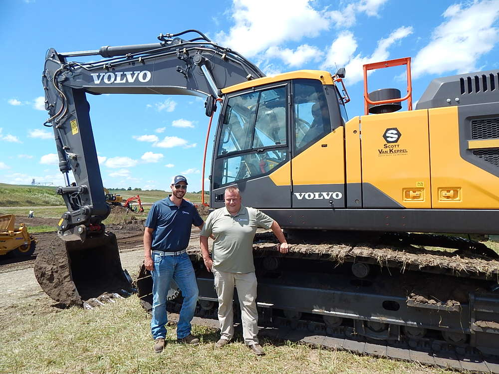 Jeff Fye (L) and Jason Bruce, territory managers of Scott Van Keppel, Ankeny, Iowa, are ready to talk with attendees about this Volvo EC350 excavator.
