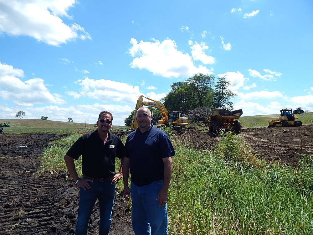 Jeff White (L), Road Machinery and Supplies territory sales manager, and Woody Fisher of Road Machinery and Supplies, Cedar Rapids location, check out the big demo area.