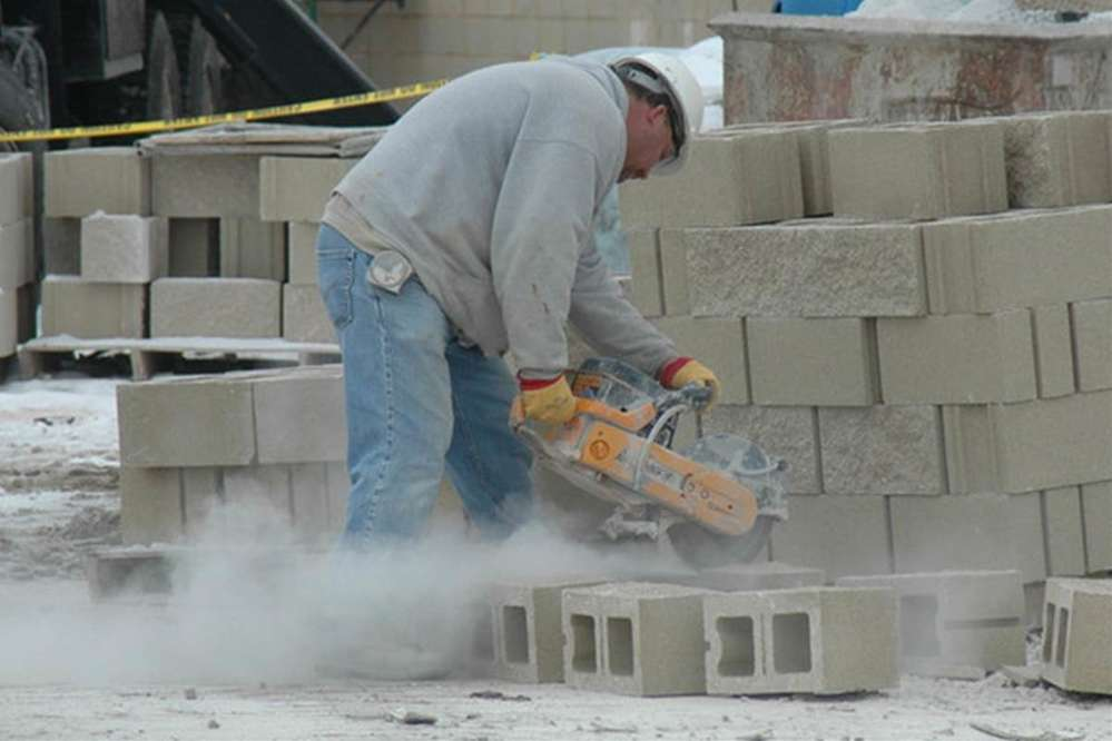With around two million construction workers exposed to respirable crystalline silica in more than 600,000 workplaces, OSHA said over 840,000 of these workers are exposed to silica levels higher than the new permissible exposure limit. (Photo Credit: NBC)