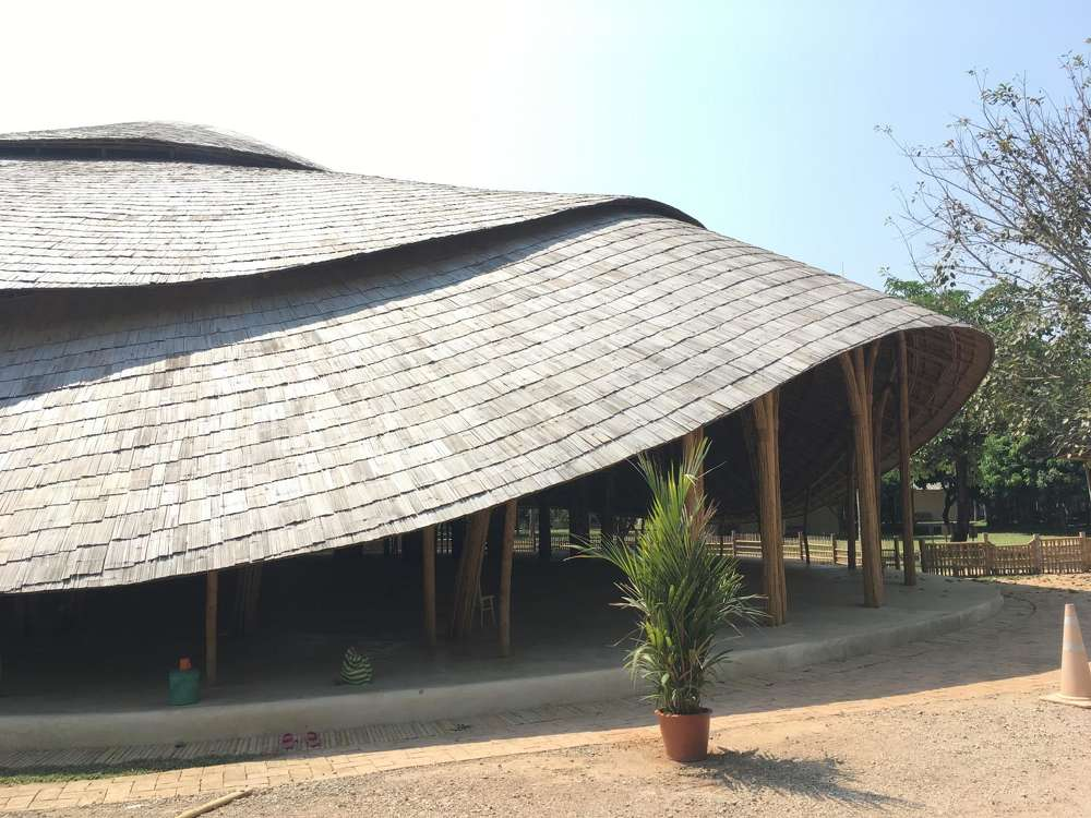 The Panyaden International School in Thailand partnered with Chiangmai Life Architects to build the arena with bamboo — a construction material strong enough to hold up under bad weather, and cool enough to support an open, ventilated floor plan. (Photo Credit: TechXplore)