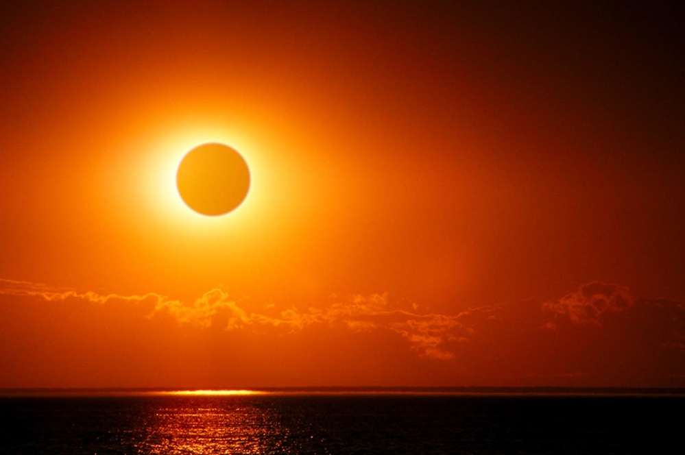 """The sun gives our planet life, brightens our days figuratively as well as literally and as the moon momentarily conceals it on this day, reminds us of the miraculous universe we all live in,together,"""" said Chao."""