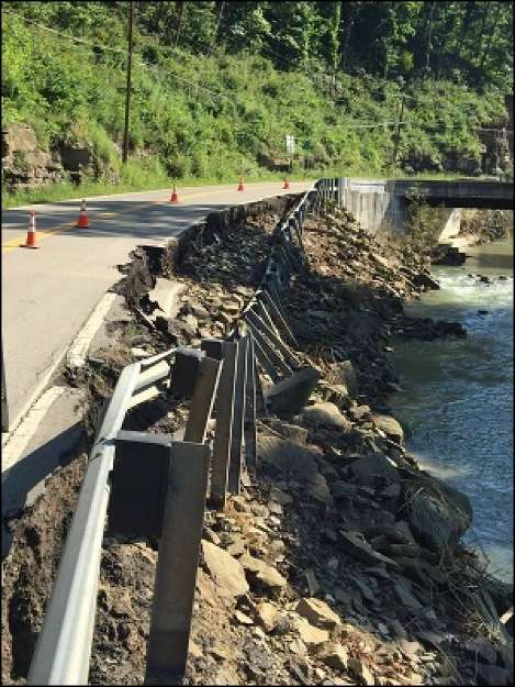 The types of roadway damage include pavement washes and scouring that undermined guardrails. (WVDOT photo)