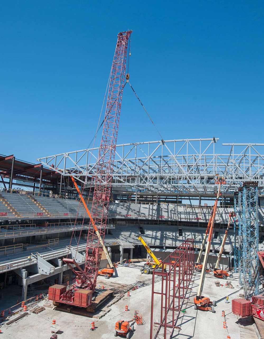 Construction of a new $524 million, multi-purpose arena is under way in downtown Milwaukee, and a fleet of Manitowoc crawler cranes is handling its most crucial lifting work.