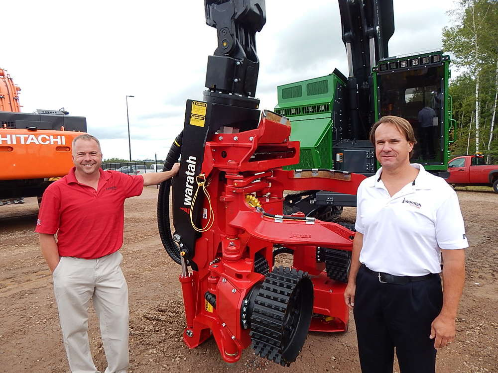 Michael Campbell (L), product support manager, and Mark Shamion, product field specialist of Waratah, Newnan, Ga., stand with the popular Waratah harvester head — the 622B.