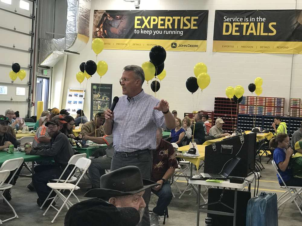 Max Guinn, president of John Deere worldwide construction and forestry, addresses the lunchtime crowd at the Merrill Grand Opening.