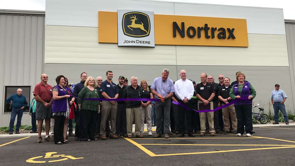 The Merrill Chamber of Commerce and Mayor Bill Bialecki, along with Max Guinn, president of John Deere worldwide construction and forestry; David Thorne, John Deere senior vice president of worldwide construction and forestry sales and marketing; Dale Gessell, Nortrax vice president, Matt Hanson, Nortrax general manager and employees were all on hand to cut the ribbon on the new Nortrax Merrill facility.