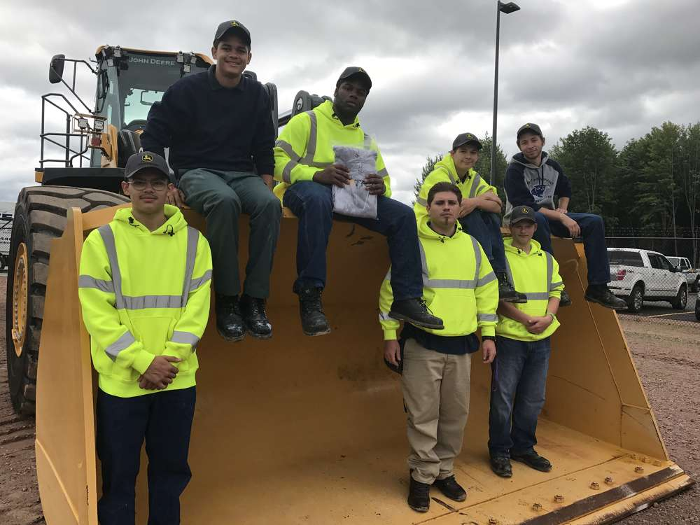 Jason Flanning, instructor of Blackwell Job Corps in Laona, Wis., brought students (L-R) Marcos Guel Jr., Cashus George, Christopher McNeal, Wes Owens, Connor Koch, Austin Gallt and Jackson Chase to experience the big equipment industry and John Deere machines in person.
