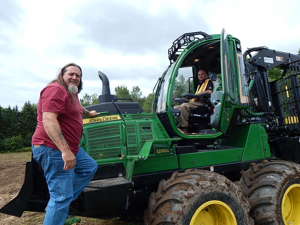 Brent Wilke (L) of Low Profile Logging, Tomahawk, Wis., checks out the John Deere 1210 logging forwarder with help from Jimmy Mylchreest, Nortrax forestry training instructor.
