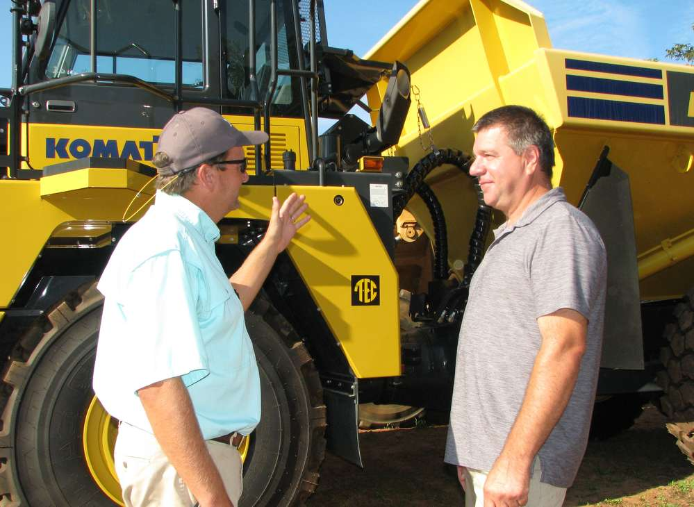 Joey Martin (L), owner of Joey Martin Auctioneers, talks with his friend Mark Doty, W.I. Clark Company, Wallingford, Conn.