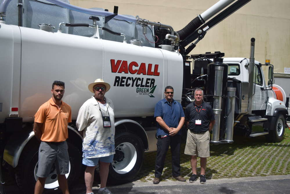 (L-R): Jared Wilson, environmental specialist, John Rosebery, sales manager, and Ismael Dominguez, territory product support, all of Great Southern Equipment Company, talk with Tod Ebetino, regional sales manager, Gradall Industries, in front of a Vacall machine.