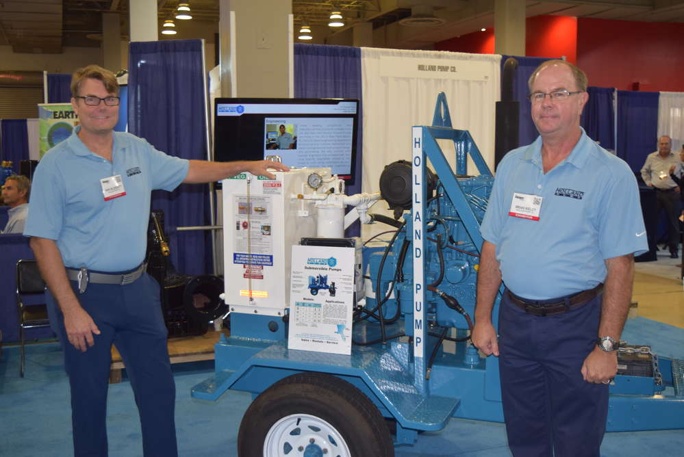 Win Blodgett (L), president of Holland Pumps and  Brian Kieley, branch manager/pump consultant, West Palm Beach, Holland Pumps, talk with customers at the Water Expo about the benefits of Holland Pumps.