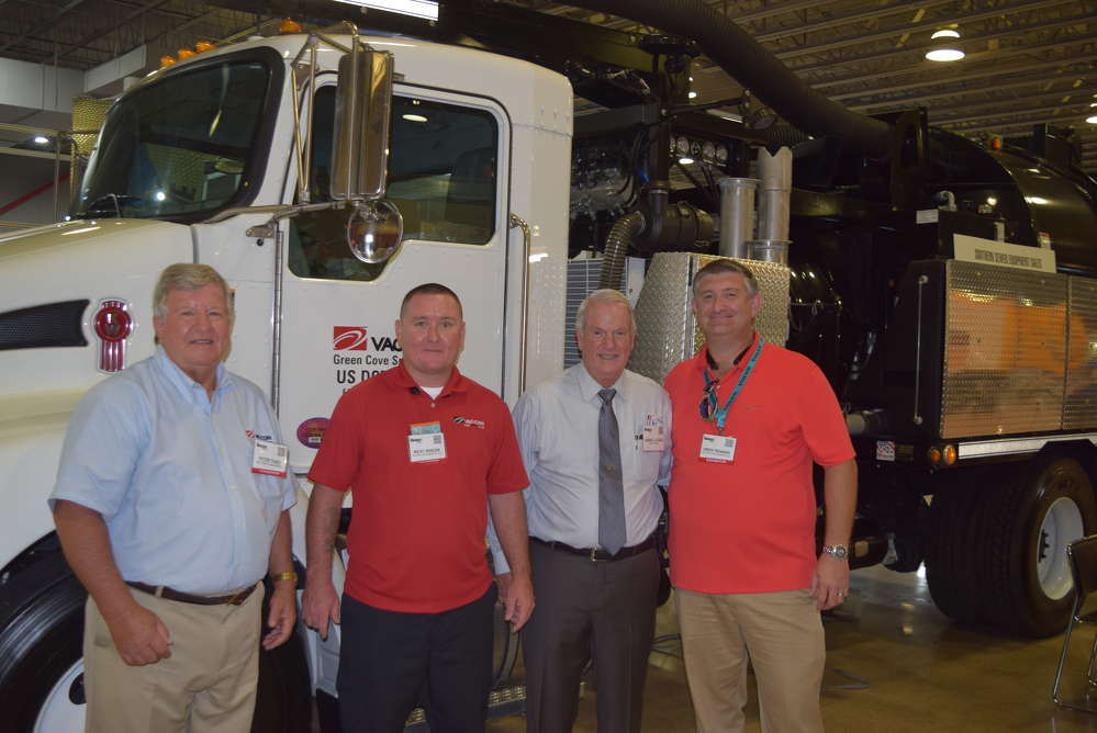 Peter Theis, director of export sales, Ricky Debusk, southern region sewer equipment sales, Darrell Lesage, president, and Drew Denmon, southern region sewer equipment sales, all of Vac-Con, stand by to take questions about the Vac-Con machine.