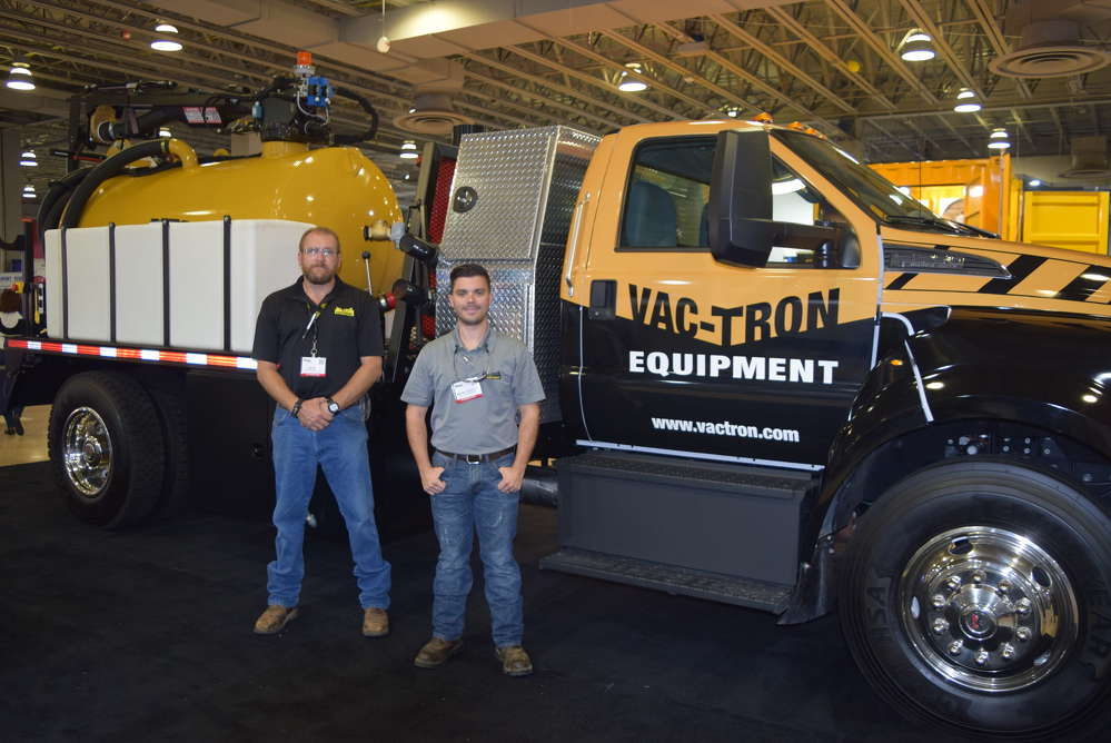 Tim Ross (L), central territory manager, and Kevin Showley, national dealer support, both of Vac-Tron work the crowd at the Water Expo in Miami.