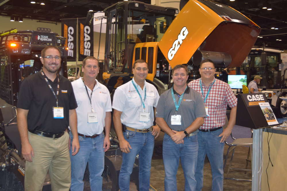 (L-R): Brad Stemper, product manager, Case Construction Equipment; and Randy Shearin, sales support, Ronald Miller, managing director and Charlie Rhodes, sales director, all of Trekker Group; and Matthew Guist, director of client safety, First 2 Aid Safety, spend some time at the Case display.