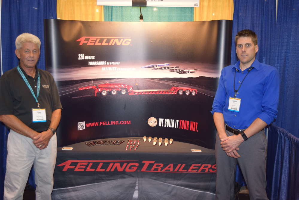 Mark Rapp (L), product manager of Felling Trailers, and Nathan Uphus, Southeast regional sales manager of Felling Trailers, talk with attendees about Felling Trailers.