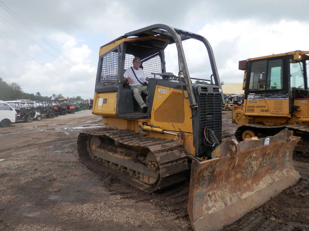 Wayne from Alabama inspects a John Deere 450J LGP crawler tractor that was sold in the Early Fall Public Auction.