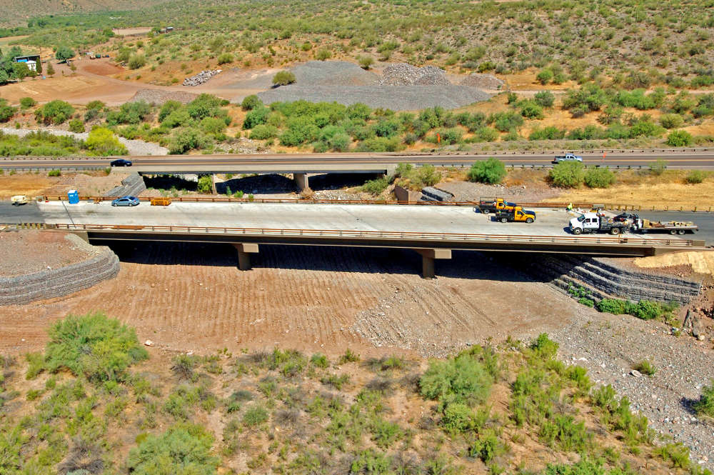 The project will require about 100,000 tons of asphalt and concrete and about 7,500 cu. yds. of concrete.  (FNF Construction/ADOT photo)