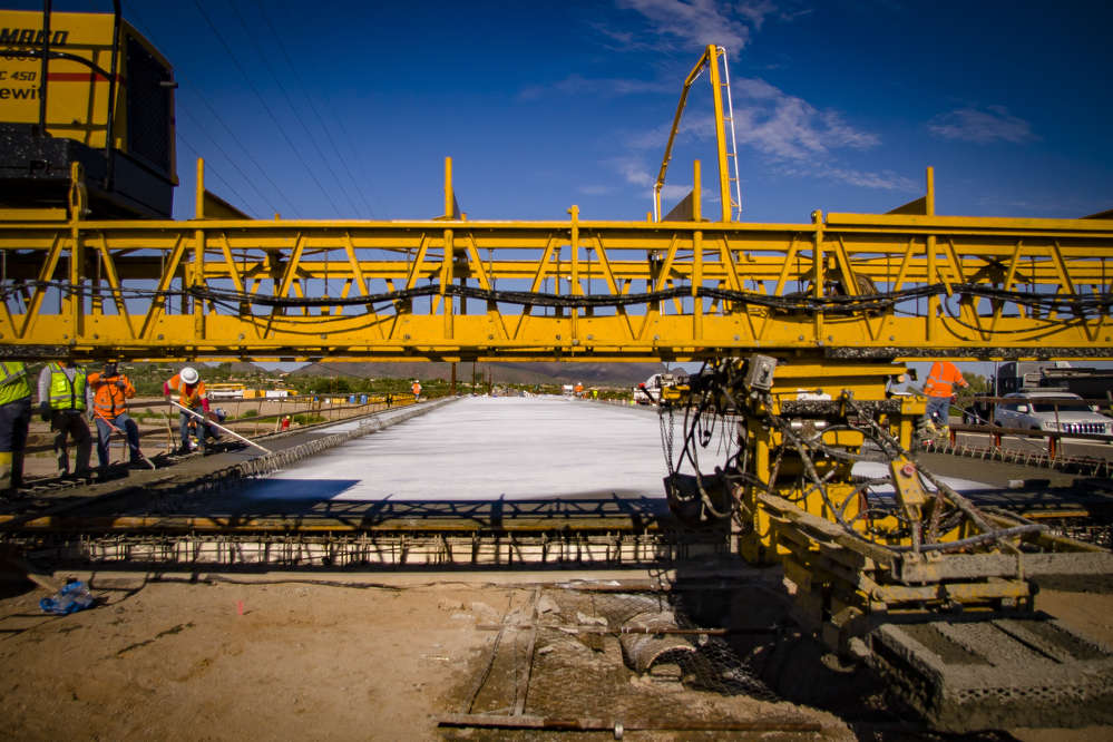 Crews recently poured concrete to create a deck for the first of two new bridges carrying Ina Road over the Santa Cruz River just west of I-10. (Arizona DOT photo)