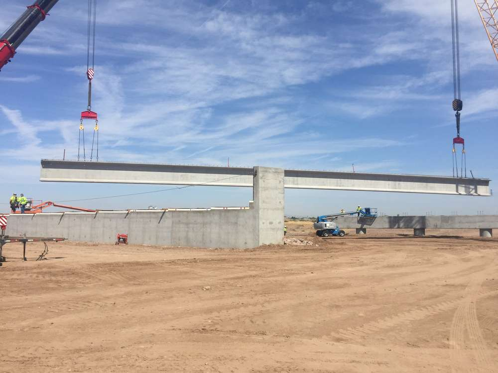 As long as a 17-story building and each weighing as much as 14 elephants, 94 extra-long single span girders have already been placed on two bridge structures that will carry traffic over the Salt River. (ADOT photo)