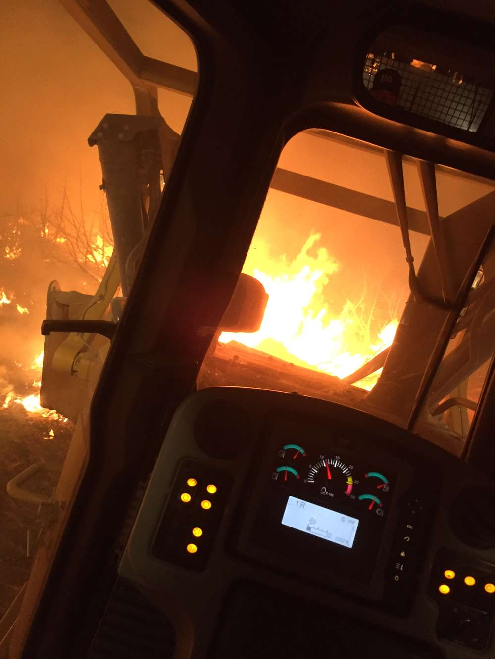 As 51 wildland fires burn in the western United States, heavy equipment is playing a big role in helping fire fighters contain the flames. (National Interagency Fire Center photo)