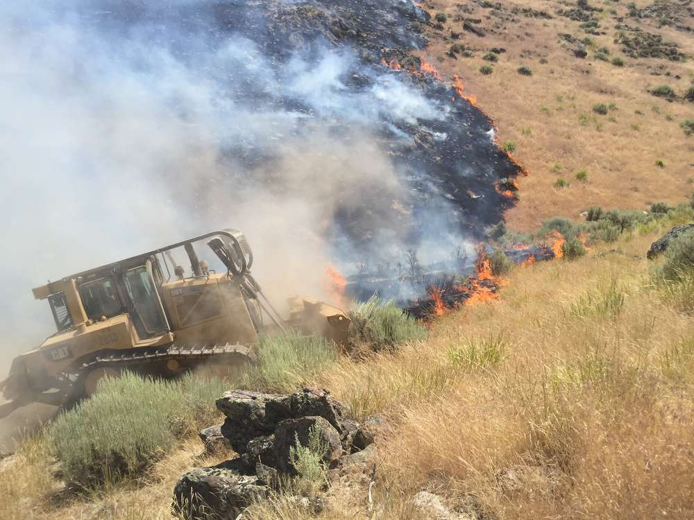 In areas where the terrain is rangeland, which includes parts of most Western states, a Caterpillar D6TXL, a type 2 bulldozer, is the equipment of choice, according to Jessica Gardetto, spokesman for the National Interagency Fire Center. (National Interagency Fire Center photo)